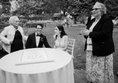Happy bride groom family at table after wedding