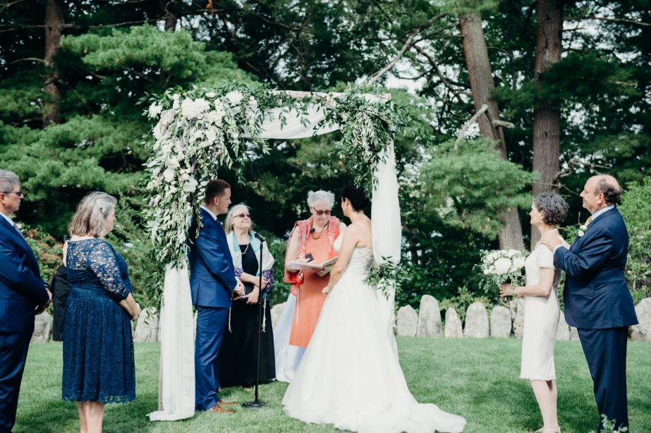beautiful outdoor wedding scene with rabbi