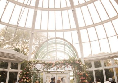 wedding ceremony in large glass room